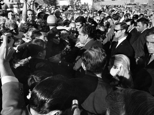 President Richard M. Nixon in the midst of a crowd in Palm Springs c. 1968.