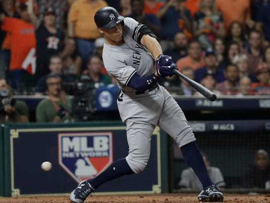 New York Yankees' Aaron Judge strikes out during the third inning of Game 6 of baseball's American League Championship Series against the Houston Astros Friday, Oct. 20, 2017, in Houston. (AP Photo/David J. Phillip)