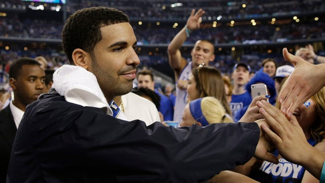 Canadian entertainer Drake greets Kentucky fans during halftime of a 2014 Final Four game.