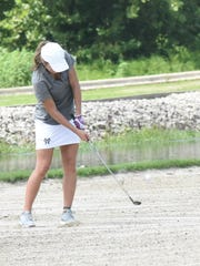 Mountain Home's Vinessa Daniel hits a shot out of the bunker on the 10th hole at Big Creek Golf & Country Club on Tuesday.
