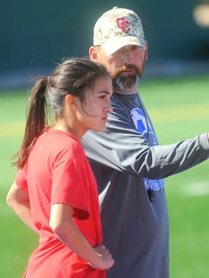 New Wylie coach Robert Alvarez, right, talks to Hayden Abor during a practice after he took over the Cooper girls soccer program at the end of the 2016 season. Alvarez was approved by the Wylie ISD school board on Monday night to take over the Lady Bulldogs.