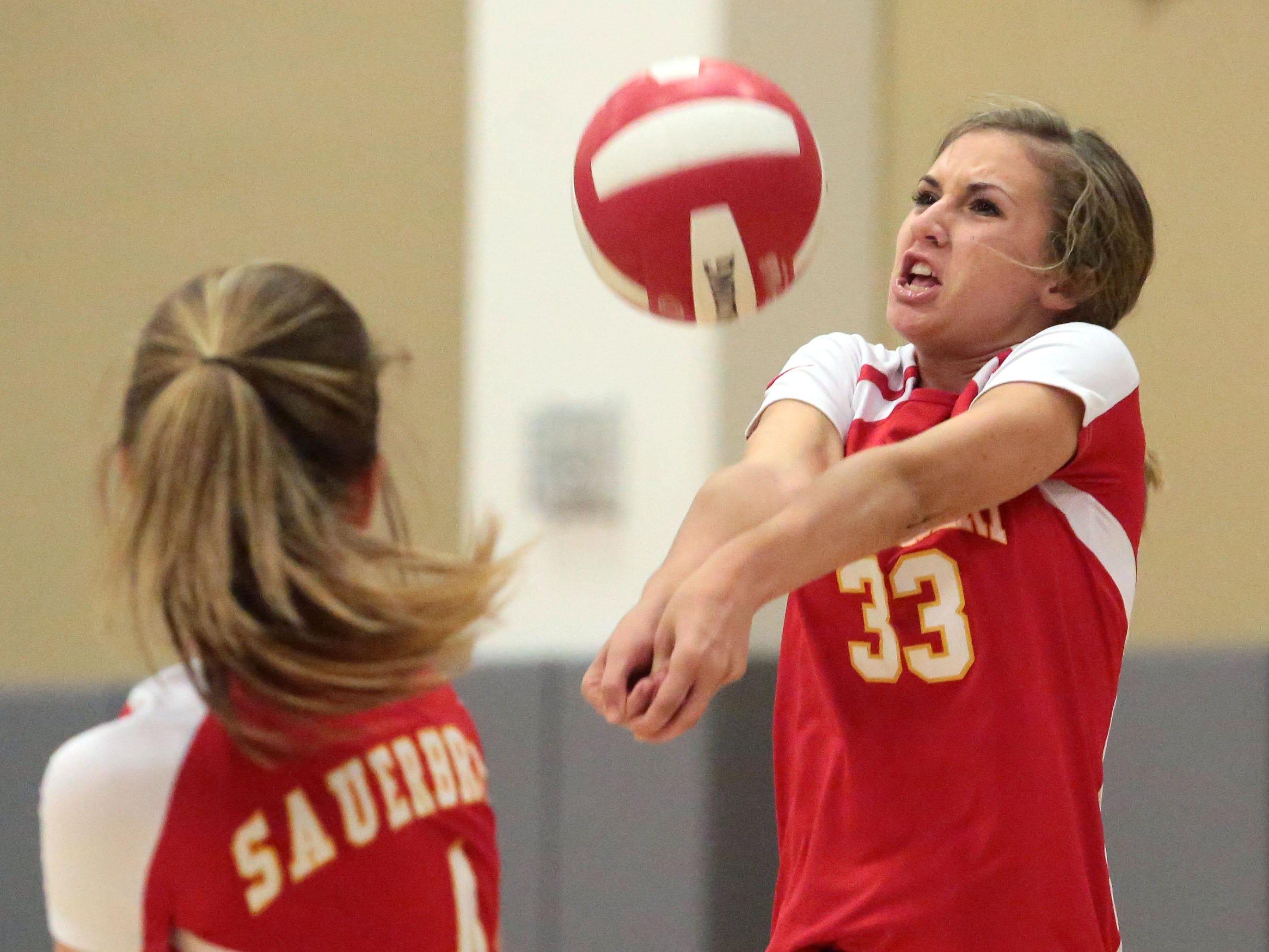 Palm Desert Maggie Welsh digs against Palm Springs on Thursday in Palm Desert.
