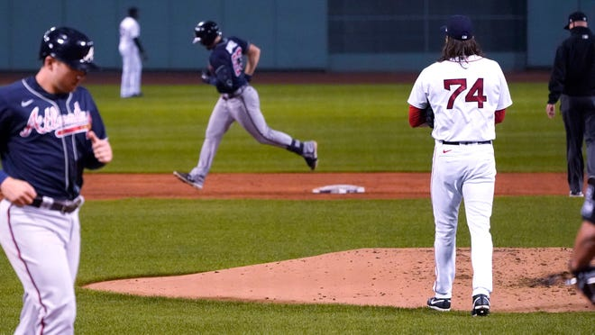 Boston Red Sox pitcher Mike Kickham (74) watches as Atlanta Braves' Adam Duvall, center, rounds the bases on Duvall's two-run home run during the second inning of a baseball game, Wednesday Sept. 2, 2020, in Boston. At left is Braves Austin Riley.