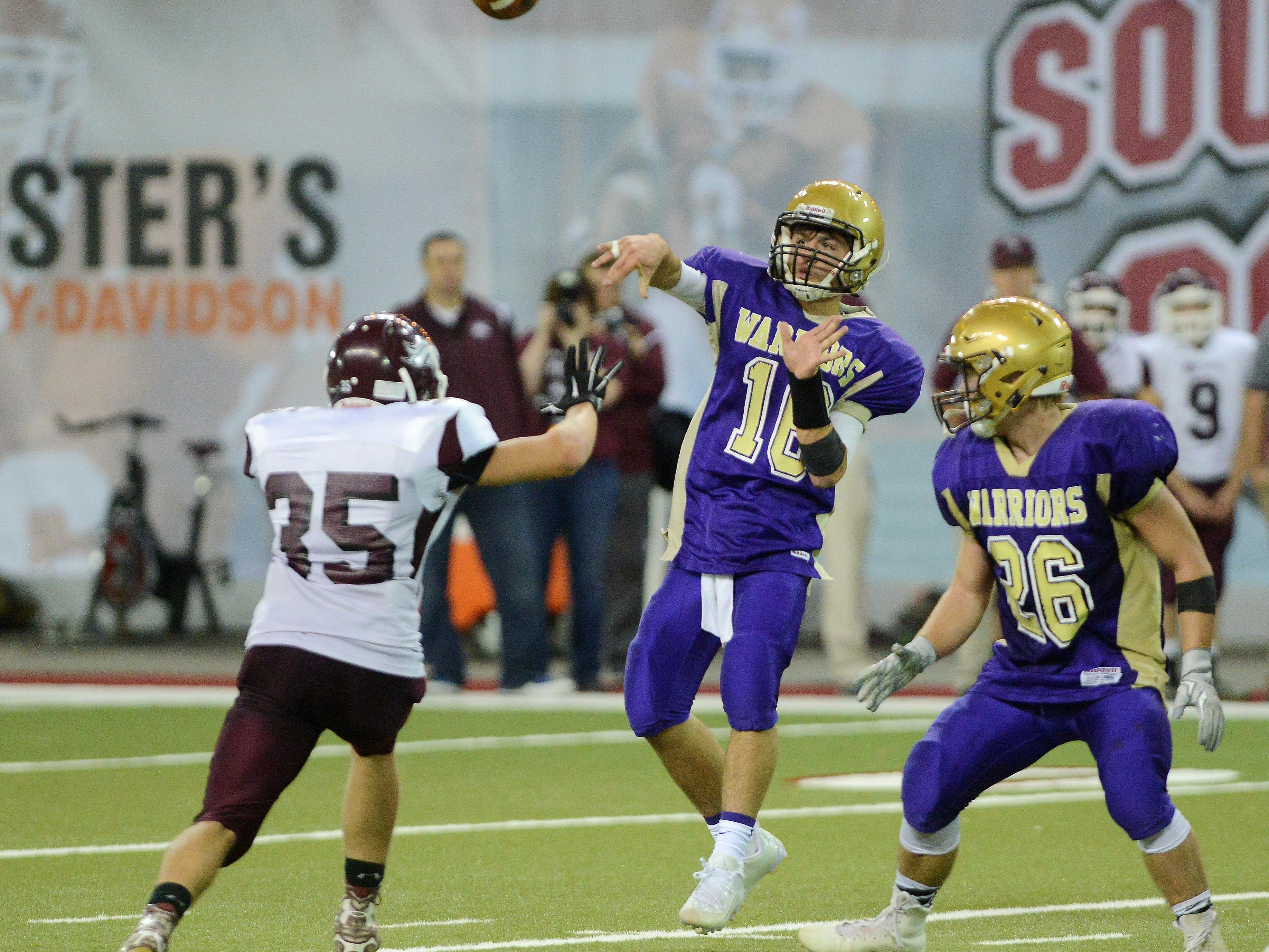Winner quarterback, Drew DeMers throws a pass past Tri-Valley's Lane Hillman in Friday's class 11B football championship at the DakotaDome in Vermillion, Nov 13, 2015. Winner beat Tri-Valley 45-6.