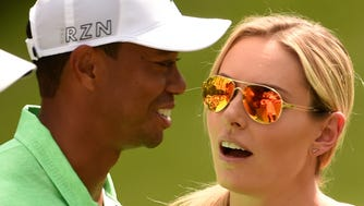 (FILES) In this April 8, 2015 file photo, golfer Tiger Woods speaks with US Skier Lindsey Vonn during the Par 3 competition Augusta National Golf Club in Augusta, Georgia. Former world number one Tiger Woods and his skiing star girlfriend of three years Lindsey Vonn have separated, it was confirmed May 3, 2015. Vonn announced the split in a statement on her Facebook page, saying the couple had parted due to incompatible schedules. Woods issued a similar statement on his website.  AFP PHOTO/TIMOTHY A. CLARY/ FILESTIMOTHY A. CLARY/AFP/Getty Images ORG XMIT: Golf: Tig ORIG FILE ID: 540345466