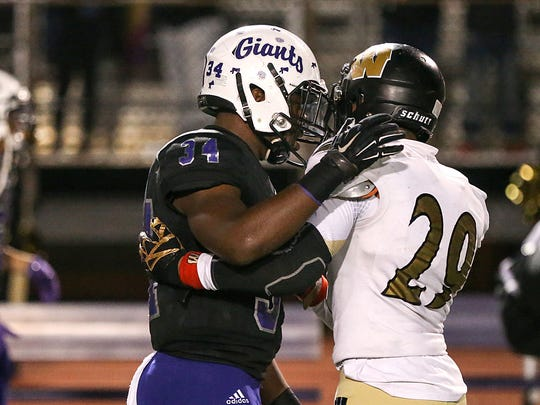 Ben Davis running back Delbert Mimms III (34) and Warren Central running back Randy Wells Jr. (29) show sportsmanship after the Giants beat the Warriors to win the 2017 sectional.