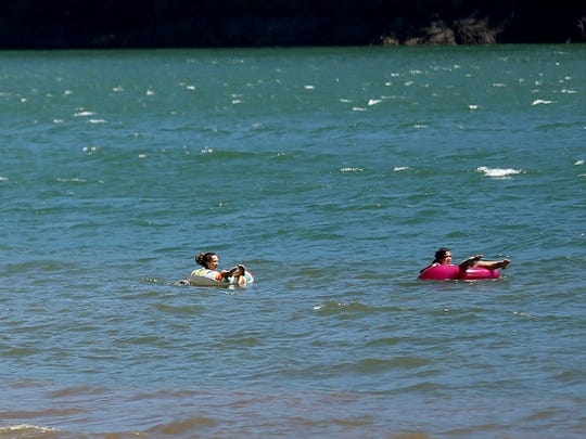 People float as a water quality advisory from the Oregon Health Authority for Detroit Lake is in effect on Monday, July 9, 2018.