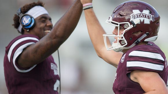 Mississippi State quarterback Nick Fitzgerald (7) gets a high five from Mississippi State quarterback Elijah Staley (2) after throwing a touchdown pass in the second half.Mississippi State played Northwestern State in a college football game on Saturday, September 19, 2015 at Davis Wade Stadium in Starkville. Photo by Keith Warren (Mandatory Photo Credit)