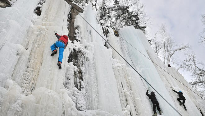 Decio Durlacher (at left in red jacket), a native of Brazil, was among ice climbers new to the sport who took advantage of a beginning-level class during the Sandstone, Minn., Ice Festival on Dec. 13.