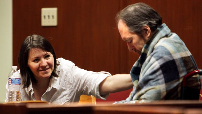 Loretta Mackenzie, left, jokes with her husband Benton Mackenzie while waiting for the jury to return during deliberations in their trial at Scott County District Court Wednesday, July 9, 2014, in Davenoirt, Iowa. The couple was found guilty manufacturing marijuana, conspiracy, violation of the drug tax stamp act and possession of drug paraphernalia, the The Quad City Times reported. Their son, Cody, 22, charged with misdemeanor possession of marijuana and paraphernalia,w as also found guilty. Mackenzie and his supporters said he grew the marijuana to treat angiosarcoma, a cancer of the blood vessels. (AP Photo/The Quad City Times, Kevin E. Schmidt) MAGS OUT, TV OUT, NO SALES