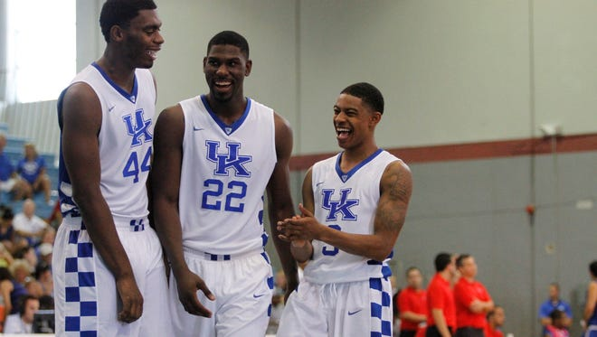 Bahamas7:  University of Kentucky freshman point guard Tyler Ulis shares a laugh with teammates Dakari Johnson and Alex Poythress during a break against the Puerto Rico national team at the Big Blue Bahamas tour in Nassau, Bahamas, August 10, 2014. Drew Fritz/Special to the Courier-Journal