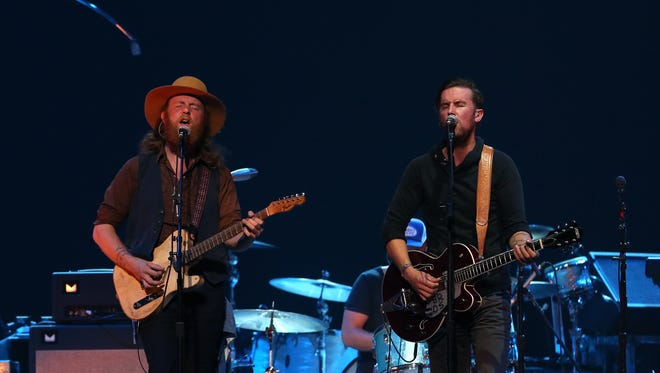 The Brothers Osborne entertain the crowd at the KFC Yum! Center on Thursday night.   Photo by Scott Utterback/The Courier-Journal Sept. 25, 2014