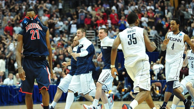 Arizona Wildcats guard Kyle Fogg (21) walks off the court after losing 65-63 against the Connecticut Huskies during the finals of the West Regional of the 2011 NCAA Men's Basketball Tournament at the Honda Center on March 26, 2011.