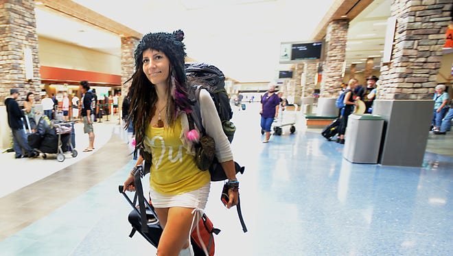 Ali Shanty of Boulder, Colo. arrives At the Reno Tahoe International Airport Friday Aug. 22, 2014 for Burning Man.