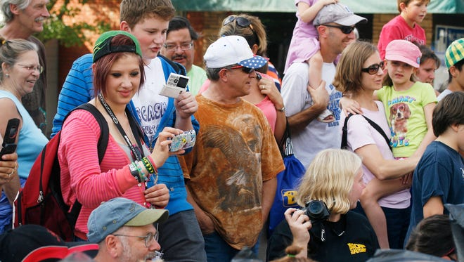 A crowd gathers to watch the pie eating contest at the annual Hop and Heritage Festival in Independence.