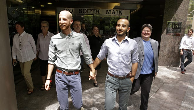 Utah plaintiffs Derek Kitchen and Moudi Sbeity are among three couples seeking to overturn the state's same-sex marriage ban.