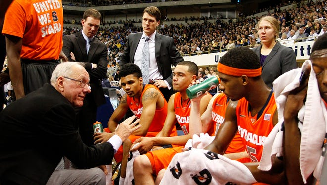 Syracuse coach Jim Boeheim talks to players during a time out against the Pittsburgh Panthers at Petersen Events Center.