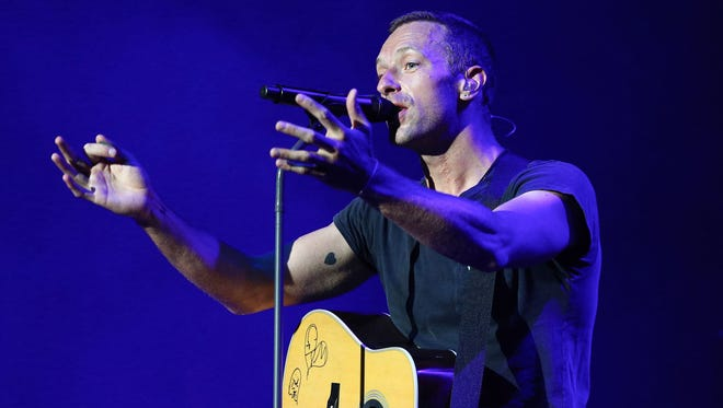 Chris Martin of Coldplay performs in Westwood, Calif.