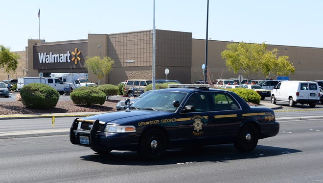 A Nevada Highway Patrol car drives near a Wal-Mart in Las Vegas, near where two police officers were shot and killed.