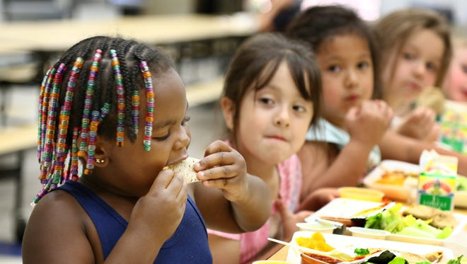 Students eat lunch at Irving Elementary School  in Sioux City, Iowa.