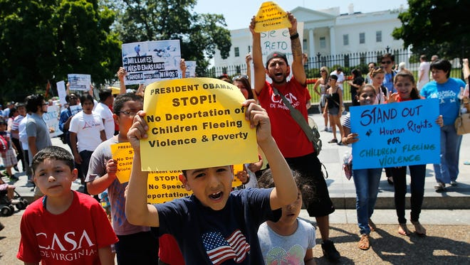 Children join immigration protesters in front of the White House on July 7.