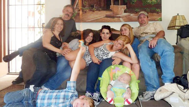 Members of the extended Anderson and Saincome families, with James Lee DiMaggio, right, are seen in this June 2011 photo provided by Andrea Saincome. Seated from left are Christina Anderson, Christopher Saincome, Christina's sisters Samantha Saincome and Andrea Saincome, their niece Hannah Anderson, (reclining), Alexi (last name unavailable, friend of Hannah's), and James Lee DiMaggio. On the floor are Ethan Anderson, left, and Andrea's infant child, whose name was not released.
