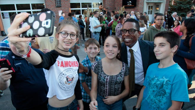 Sleepy Hollow cast member Orlando Jones joins a selfie with fans, from left, Calista Sheenan, Cole Sheenan, Casandra Keenan, and Colin Keenan as he and fellow cast member Lyndie Greenwood visit the village the hit T.V. series from FOX is based upon on Friday.