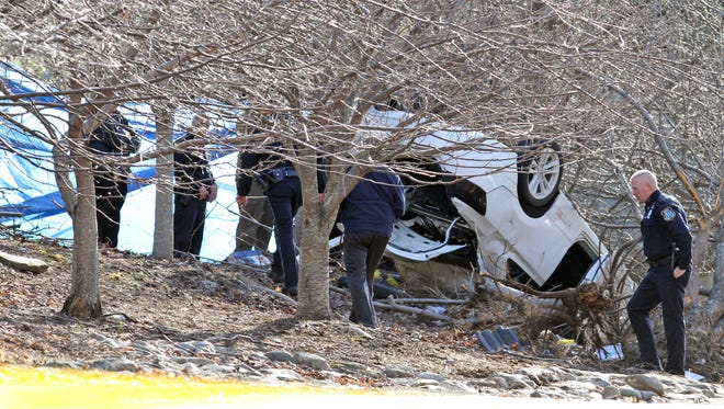 Investigators work at the scene of a fatal car accident on Gate Hill Road in Stony Point April 9.
