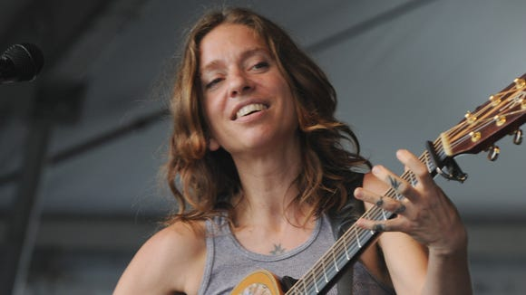 Ani DiFranco performs during the 2012 New Orleans Jazz & Heritage Festival in New Orleans.