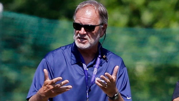 Former Baltimore Ravens coach Brian Billick addresses the team Aug. 5, 2015, in Owings Mills, Md.