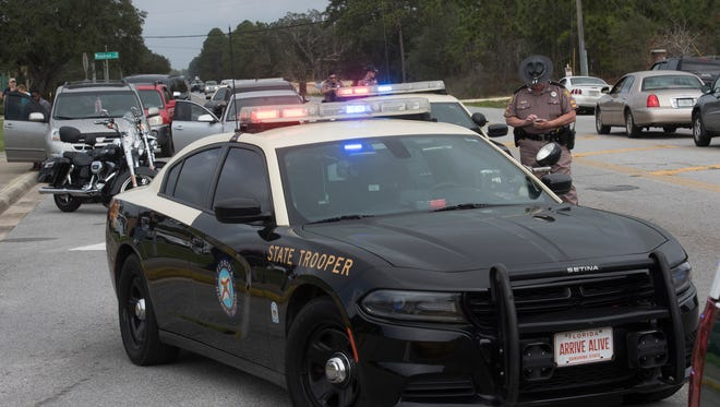 Escambia County Sheriff's Office deputies and other law enforcement officials are on scene at Bailey Middle School investigating a possible firearms threat Wednesday, Feb. 28, 2018.