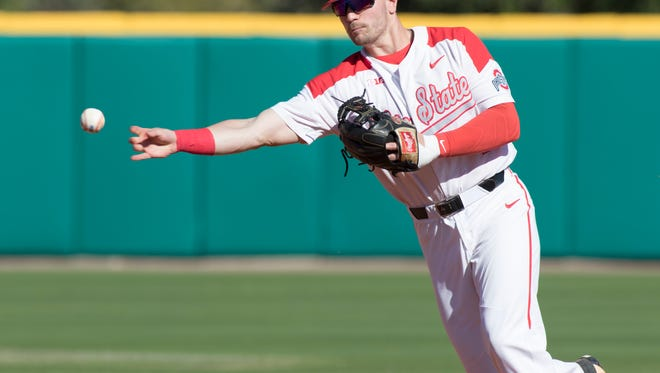 Ohio State's Brady Cherry (1) tosses to first base for an out during the Nicholls State vs Ohio State baseball game as part of the Cox Diamond Invitational in Pensacola on Friday.