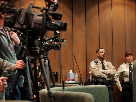 Cameras crowd the jury box before the start of a hearing
