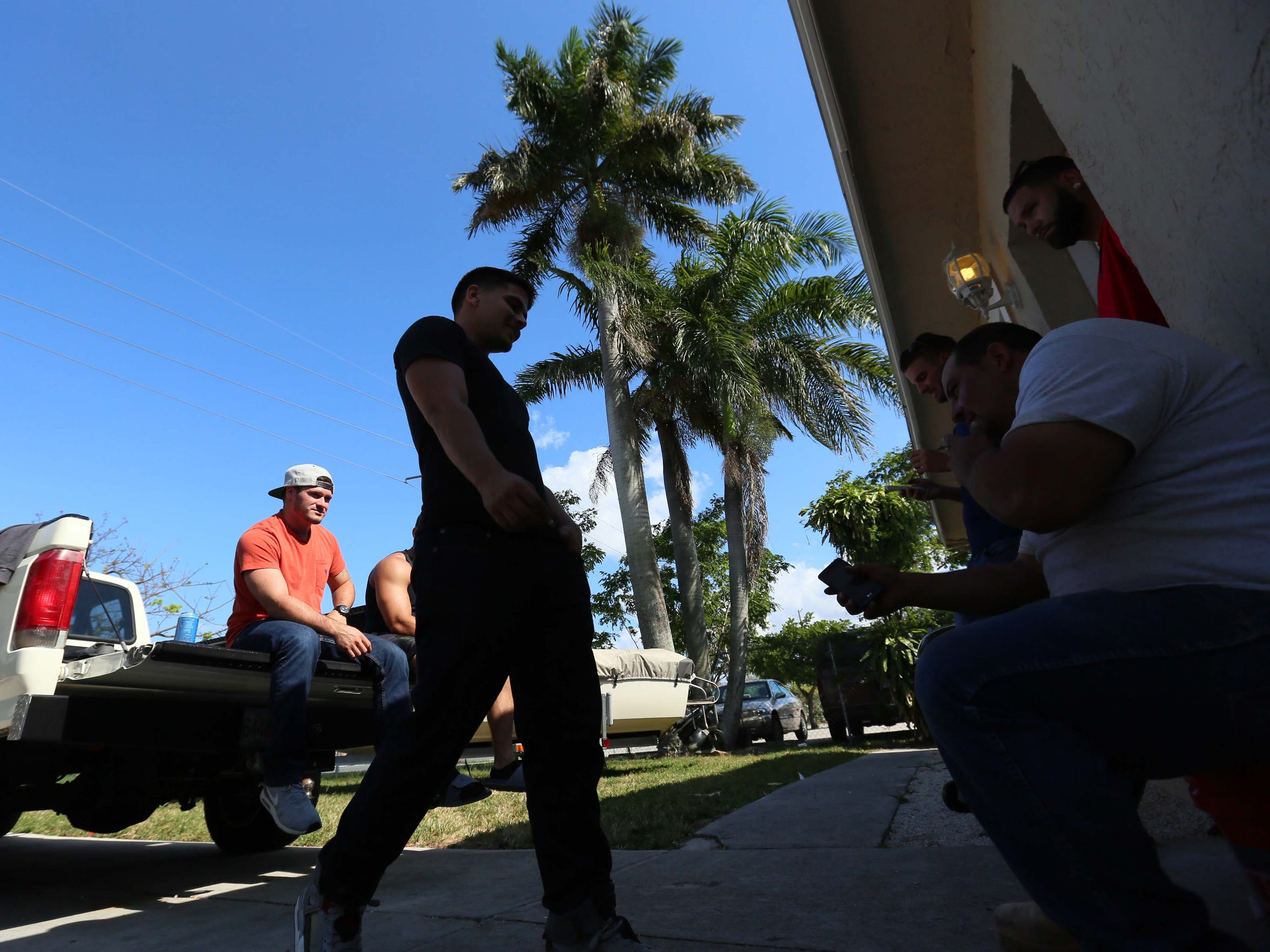 Marc Blum hangs out with his roommates from a recovery house in Delray Beach, Fla.