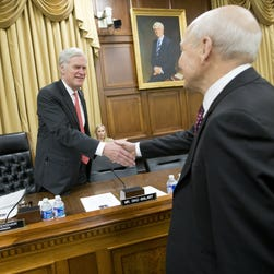 Rep. Ander Crenshaw, left,   greets IRS Commissioner John Koskinen on Capitol Hill in April at a budget hearing.