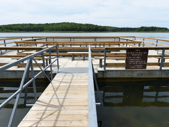 This fishing dock at Cranfield on Norfork Lake is one of a number of handicapped accessible fishing sites in the Twin Lakes Area.
