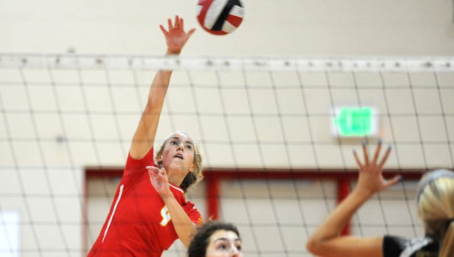 DSHA's Tess Murphy hits the ball against Oconomowoc during the championship volleyball match.