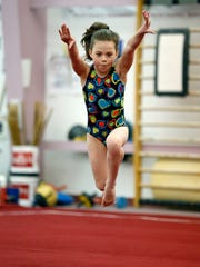 Emily Bremer, 8, of Victor speeds up during a floor