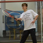 Junior squash players anxiously await the touring pros