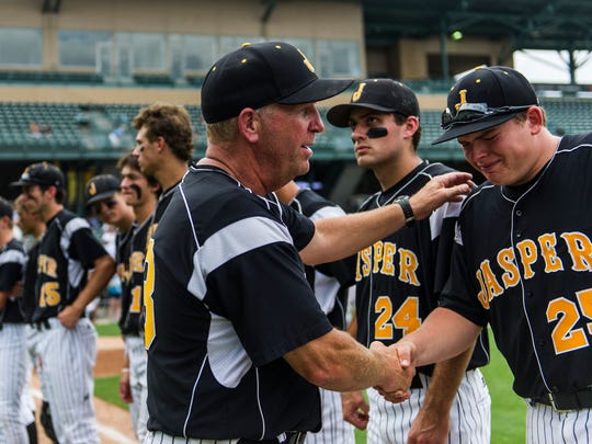 Jasper Head Coach Terry Gobert shakes Mason Thewes (25) hand after their team lost the Class 3A state championship to the South Bend St. Joseph Indians at Victory Field in Indianapolis, Ind., on Saturday, June 17, 2017. The St. Joseph Indians shut out the Jasper Wildcats, 4-0.