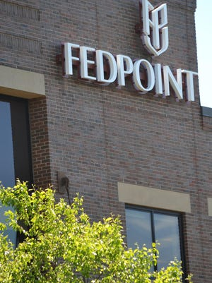 The new FedPoint logo has been placed at the company's headquarters at 100 Arboretum Drive on the Newington side of the Pease International Tradeport.