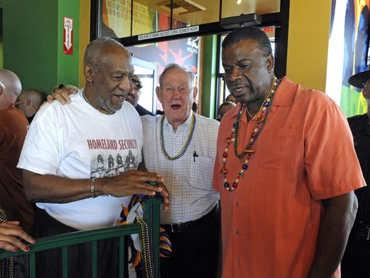 Reno Mayor Bob Cashell, center, talks with comedian Bil Cosby, left,  and restaurant owner Luther Mack at the opening of the new Popeyes Louisiana Kitchen restaurant in Sparks on Sunday, August 8, 2010.