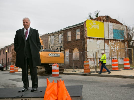 Wilmington Mayor Michael Purzycki speaks at a press conference where long vacant buildings at 50 and 52 East 22nd Street were demolished Monday morning to make way for affordable housing for first-time homeowners.