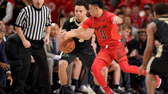 Maryland guard Anthony Cowan (0) tries to get the ball