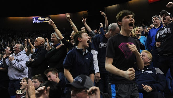 Wolf Pack fans celebrate Nevada's home win over UNLV in 2016.
