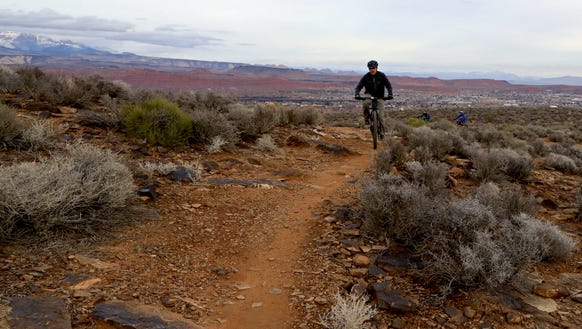 Mountain bikers ascend the Barrel Roll Trail in the