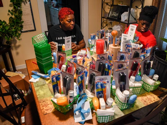 Jerrilyn Collier makes gift baskets with her grand-daughter