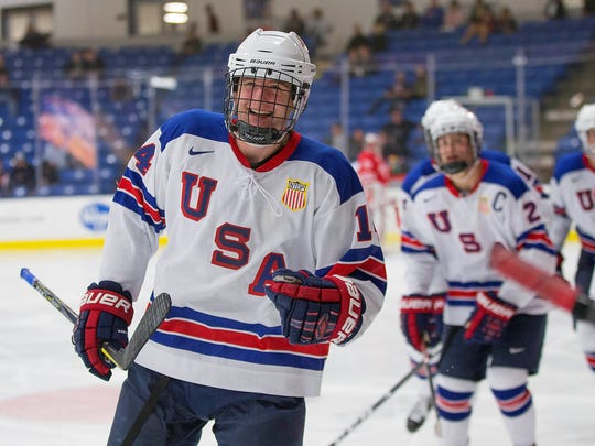 Jack DeBoer (14) is all smiles after Team USA scores during a recent game.