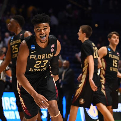 Florida State Seminoles guard M.J. Walker (23) reacts