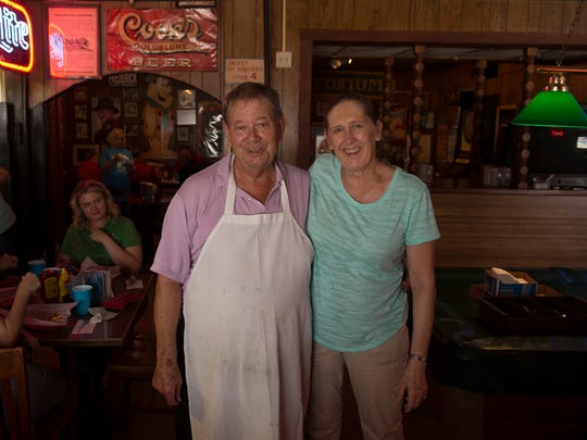 Fred and Barbara Willman take a moment to pose for a portrait on the second-to-last day of business at Fred's Bar & Grill Friday. The couple are retiring after 29 years of serving food and drinks to a supportive Evansville crowd.